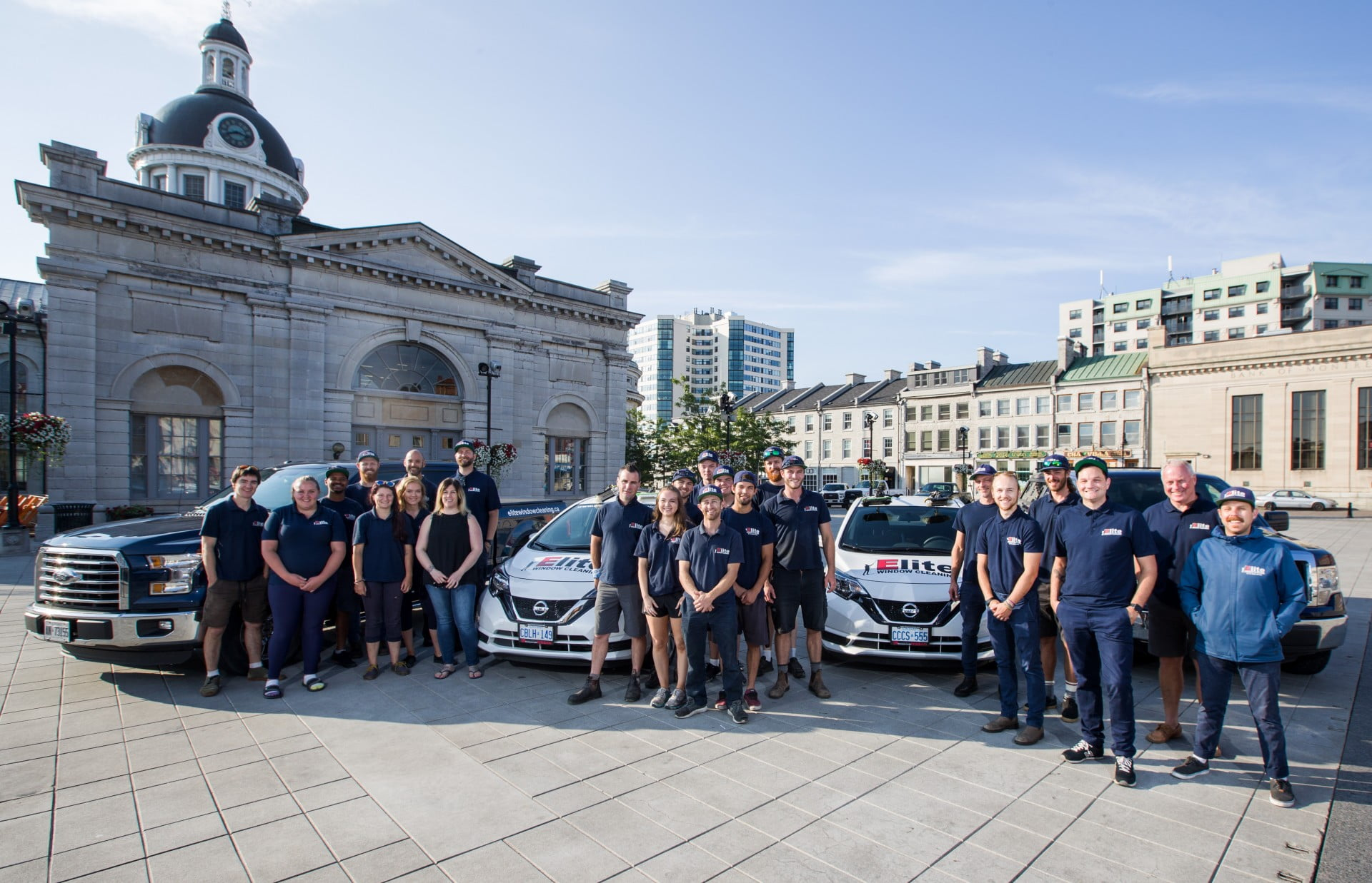 Elite Window Cleaning Team Photo in front of Kingston City Hall